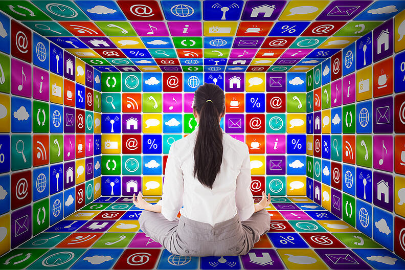 Businesswoman sitting in lotus pose against app room