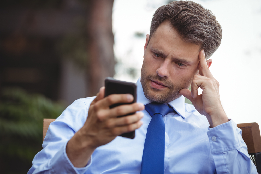 Portrait of businessman talking on mobile phone-1